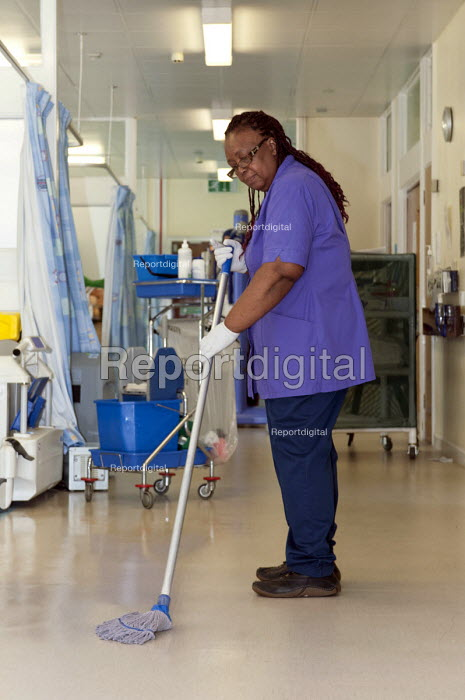An NHS housekeeper mopping the floor, Moseley Hall Hospital, Birmingham - Timm Sonnenschein - 2012-07-25