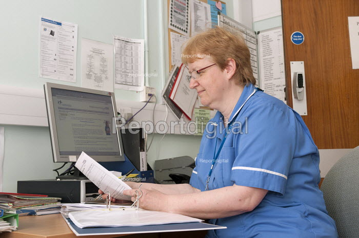 NHS nurse working on patient files, Moseley Hall Hospital, Birmingham - Timm Sonnenschein - 2012-07-25