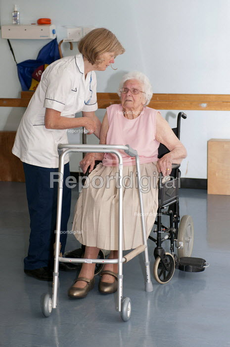 NHS physiotherapist helping an elderly patient recovering mobility, Moseley Hospital, Birmingham - Timm Sonnenschein - 2012-07-25