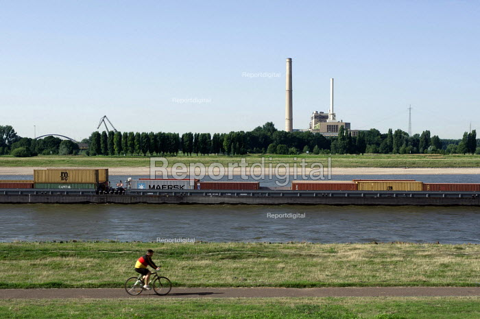Lindos barge. River Rhine photographed from Dusseldorf Oberkassel showing the gas and steam turbine power station Lausward. Photographed from the river banks where Andreas Gursky took his Rhein II photograph of which a print was auctioned for 4338500 ( 2.7m) making it at that point the most expensive photograph ever sold. - Timm Sonnenschein - 2012-08-19
