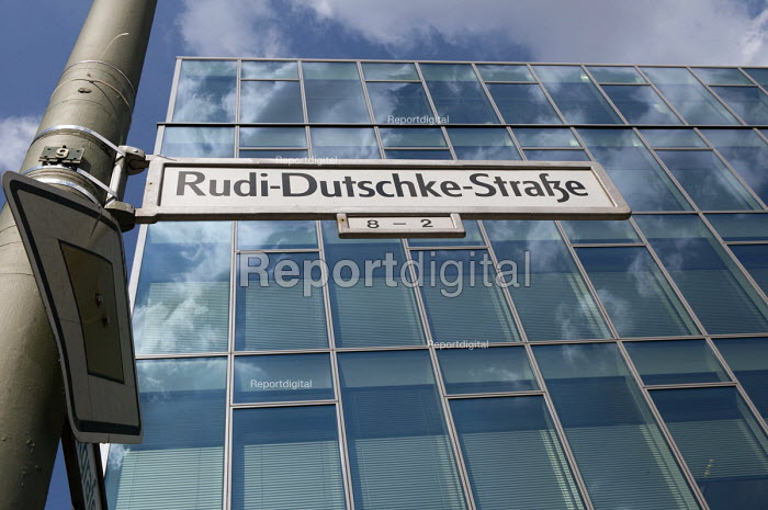 The renamed Rudi Dutschke Strase outside the the Axel Springer publishing house headquarters, Berlin. Rudi Dutschke was a Marxist German student leader of the 1960. In the 1960s the student movement was in a constant struggle with the reactionary Springer press and their daily newspaper Bild Zeitung. Rudi Dutschke survived an attempted assassination by a right winger. At the same time the Bild Zeitung was campaigning against the student movement and calling for the arrest of their leaders. The renaming of the road took place in 2008 on the 68th birthday of the late Rudi Dutschke. - Timm Sonnenschein - 2012-08-29