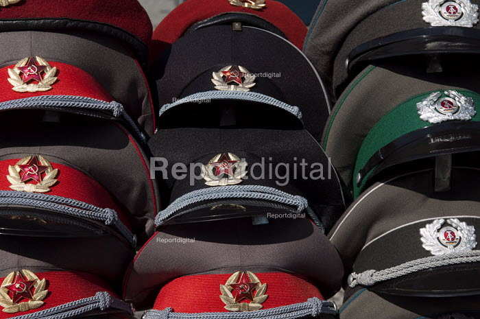 Russian Soviet Union (with the hammer and sickle emblem) and GDR army hats for sale, Berlin, Germany - Timm Sonnenschein - 2012-08-29