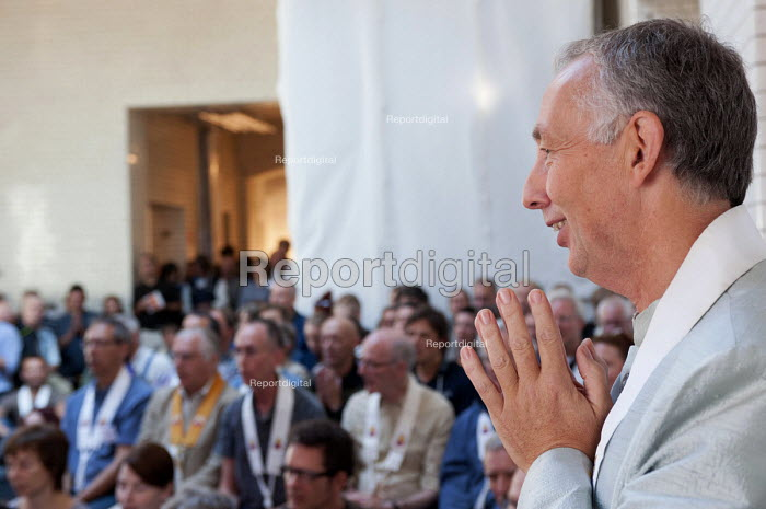 Buddhists chant during the inauguration of the Berlin Triratna Buddhist Centre, Kreuzberg, Germany - Timm Sonnenschein - 2012-09-01