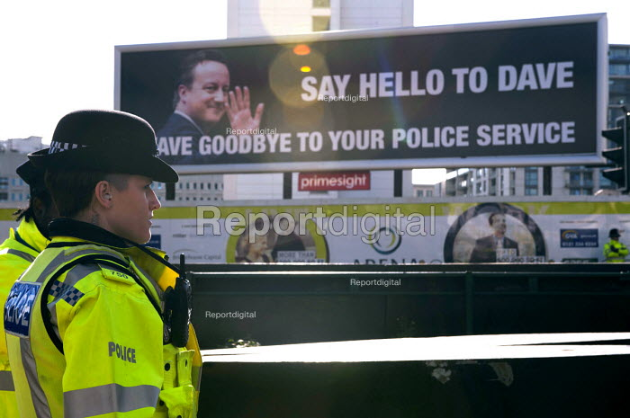 Police officer by West Midlands Police Federation poster Say hello to Dave, wave goodbye to your police service, Conservative Party conference, Birmingham - Timm Sonnenschein - 2012-10-07