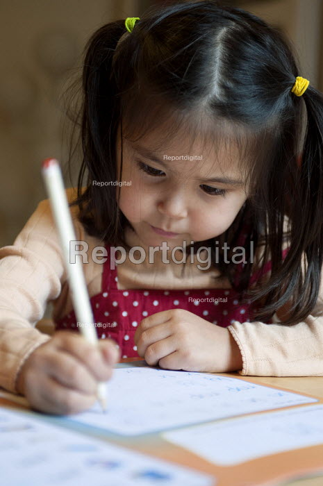 A year one schoolgirl practicing neat writing, doing her homework. - Timm Sonnenschein - 2012-07-08