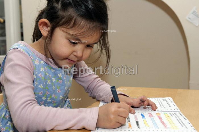 A year one schoolgirl calculating the pairs that make ten, doing her maths homework - Timm Sonnenschein - 2012-10-13