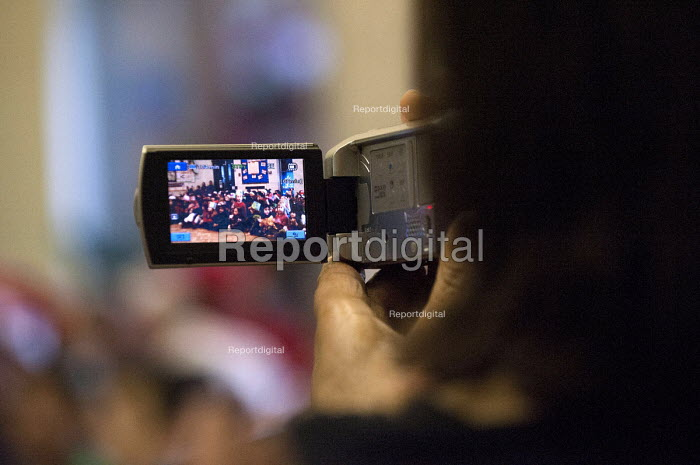A mother filming her child singing Christmas carols at Kings Heath Primary School, Birmingham - Timm Sonnenschein - 2012-12-17
