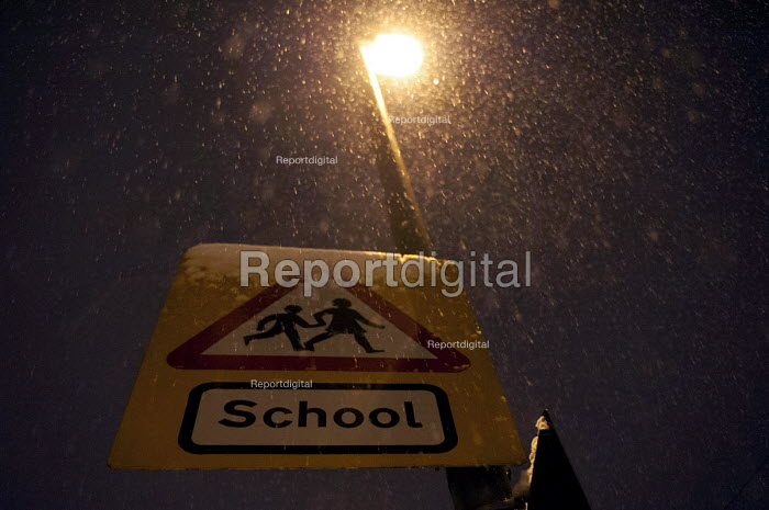 Birmingham School road sign covered in snow as schools are closed and traffic is interrupted by continuous snowfall and low tempatures below zero. - Timm Sonnenschein - 2013-01-20