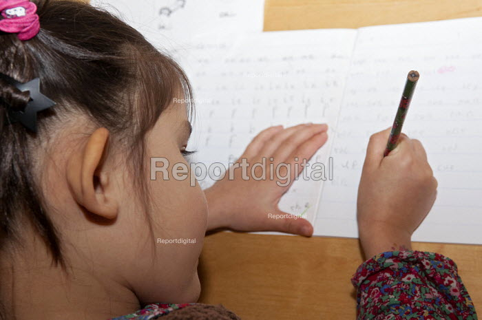 A year one school girl practicing neat writing during her homework - Timm Sonnenschein - 2012-12-02