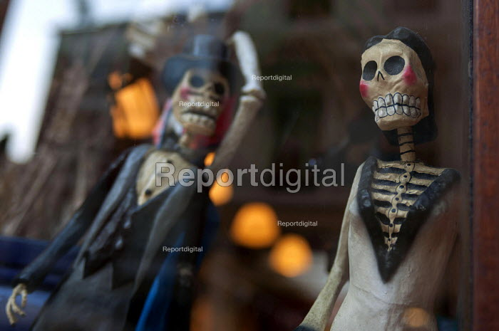 Mexican Day of the Dead bride and groom figures on display in a London bar window. El Dia de los Muertos is a joyful and sacred time, a time to welcome the souls of the dead it is a celebration in which the living and the dead are joined if even for a short while - Timm Sonnenschein - 2013-02-19