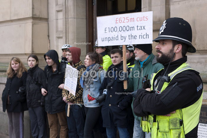 Protesters blockade the entrances to the Birmingham Council House to prevent councillors to enter for their budget meeting as the Labour run council has plans to vote for 102m cuts. - Timm Sonnenschein - 2013-02-26