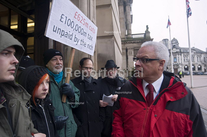 Labour councillor Martin �Straker Weld �trying to enter the council meeting as protesters �blockade the entrances to the Birmingham Council House to prevent councillors to enter for their budget meeting as the Labour run council has plans to vote for �102m cuts. - Timm Sonnenschein - 2013-02-26