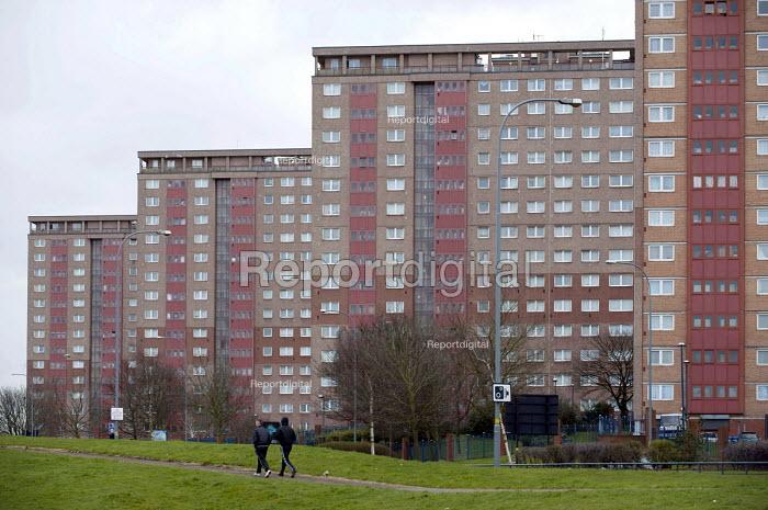 Youth walking past a high rise tower blocks, council housing estate, Newtown, Birmingham - Timm Sonnenschein - 2013-03-12
