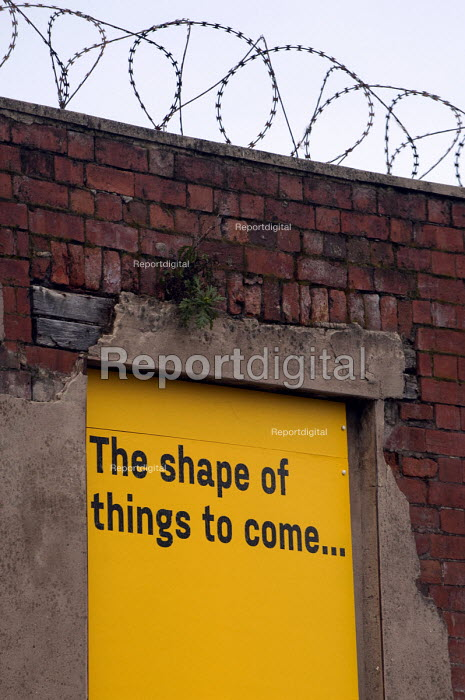 The shape of things to come... barbed wire and street art on a former entrance of a derelict factory, Sheffield - Timm Sonnenschein - 2013-03-16