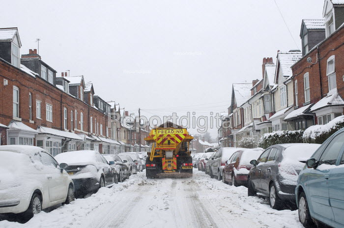 An Amey/Birmingham City Council gritting lorry spreading salt in a residential area of Birmingham �as continuous snowfall disrupts travel and transport - Timm Sonnenschein - 2013-03-24