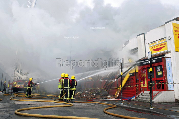 West Midlands Firefighters attending a fire that broke out in a Cash Converters shop, suspected arson, Kings Heath, Birmingham - Timm Sonnenschein - 2013-03-27