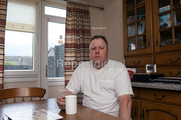 Michael, in his council flat in Ladywood, Birmingham. He was asked to pay bedroom tax for two room, which would take him into debt. He initially moved in the house with his parents in 1970, later lived here with his son and sister. Both have moved on but his son will return within a year. Michael a building worker on sickness benefit is supposed to bring up 11 per extra room per week. Ladywood has the highest number of people in Birmingham effected by the bedroom tax. - Timm Sonnenschein - 2013-05-08