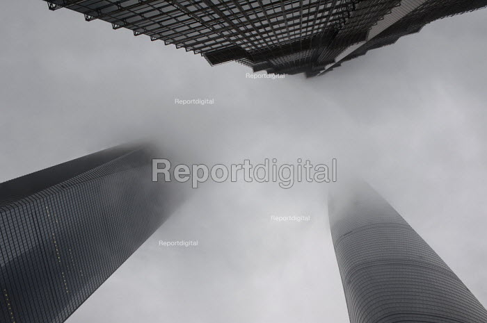The three tallest Shanghai buildings Shanghai Tower, Shanghai World Financial Center and Jin Mao Tower disappear in a mix of smog and clouds, Pudong, Shanghai China - Timm Sonnenschein - 2014-04-19