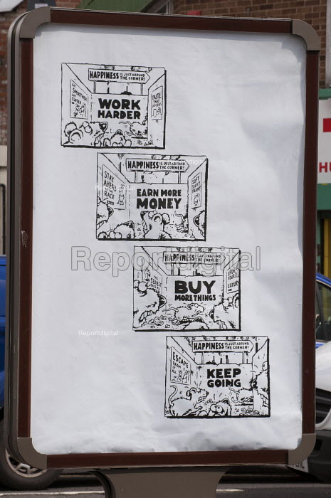 Work Harder. Anti Consumerist poster, replacing official adverts in an activist campaign against the corporate take-over of public space, Birmingham. - Timm Sonnenschein - 2014-05-13