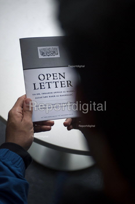 Young man reading the Open Letter to ISIS, Birmingham. A letter intended to combat extremism addressed to Dr. Ibrahim Awwad Al-Badri, alias Abu Bakr Al-Baghadi and to the fighters and followers of the self-declared Islamic State - Timm Sonnenschein - 2015-05-20