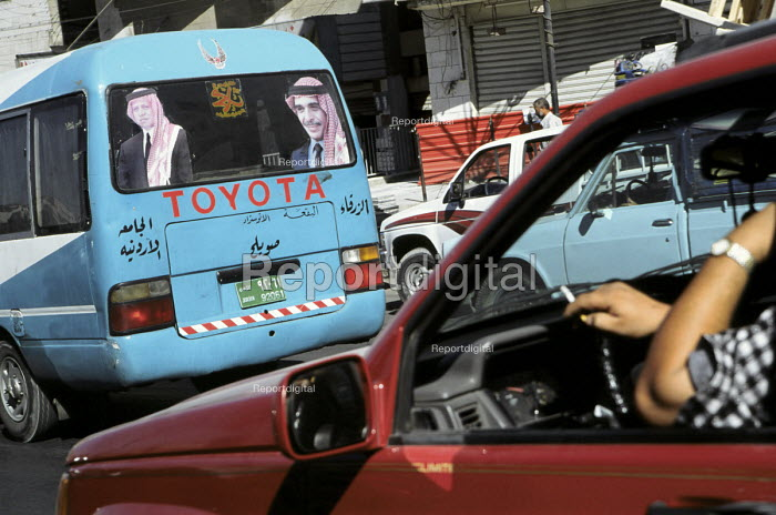 A strong sense of national pride within Jordanian society - one of many vehicles displaying images of both the past and present King of Jordan King Abdullah and his father the late King Hussein. Amman, Jordan, 2004 - Steven Langdon - 2004-03-01