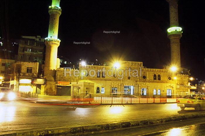 View of night scene of Husseini Mosque in the downtown area near King Faysal Street, Amman. Jordan, 2004 - Steven Langdon - 2004-03-01