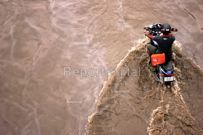 Motorcycle going through water. Each year during the monsoon, Indias capital New Delhi suffers from flooding. - Tashi Tobgyal - 2007-10-11