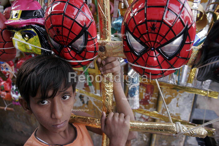 A young boy sells plastic toys in order to earn for his family, New Delhi, India. Even though many laws prohibiting child labour has been passed in the State, the legislation has proved ineffective. - Tashi Tobgyal - 2008-01-24