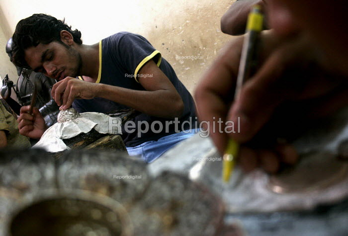 Nepalese Silversmiths work at a factory in Majnu ka Tilla, Delhi, India. These workers are from the Newar cast of Nepal and known for their excellent silver craftsmanship and skill - Tashi Tobgyal - 2009-02-03
