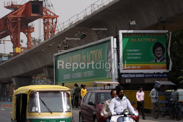 Delhi Mayor, Aarti Mehra BJP election candidate hoarding at a Metro construction site in New Delhi, India. National Democratic Alliance (NDA) - Tashi Tobgyal - 2009-05-05