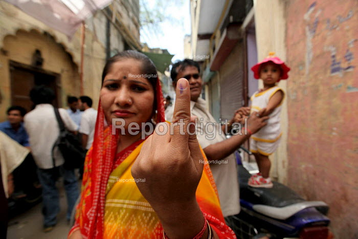 A voter with dye on her finger after casting her vote at Turkman Gate, Chandni Chowk, New Delhi.The capital went to polls on thursday. - Tashi Tobgyal - 2009-05-07