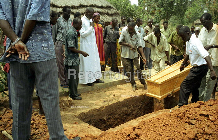 The funeral of a man married with five children, who was one of three villagers killed by LRA rebels while they tried to protect his village from an attack. Three other men were abducted and killed nearby. Gulu, northern Uganda 2005 - Thomas Morley - 2005-03-16