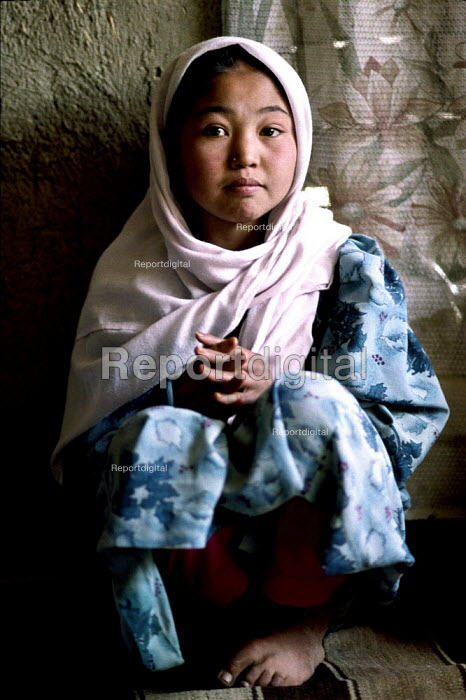 Girl whose father was killed in the Afghan civil war whose mother now widowed has five children to look after. Kabul, Afghanistan 2002 - Thomas Morley - 2002-03-05