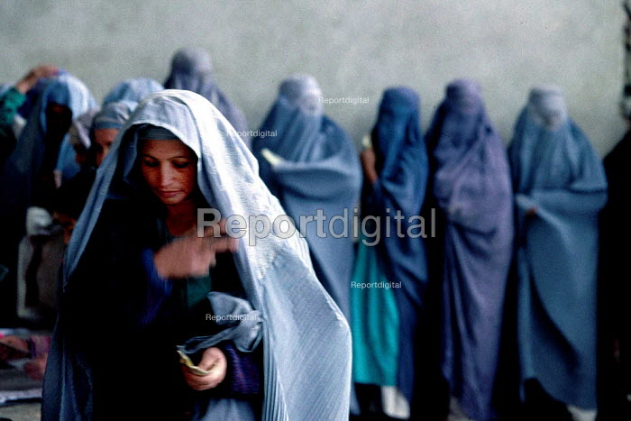 Afghan woman at a support centre for women who have been widowed by the Afghan civil war. The centre offers them food rations on a monthly basis. Kabul , Afghanistan 2002 - Thomas Morley - 2002-03-05