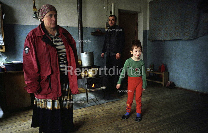 Chechen refugee families living in a camp formerly a Soviet military camp in Georgia. The refugees from Grozny and nearby villages had walked to Georgia. Duisi, Pankisi Gorge, Georgia 2003 - Thomas Morley - 2003-02-05