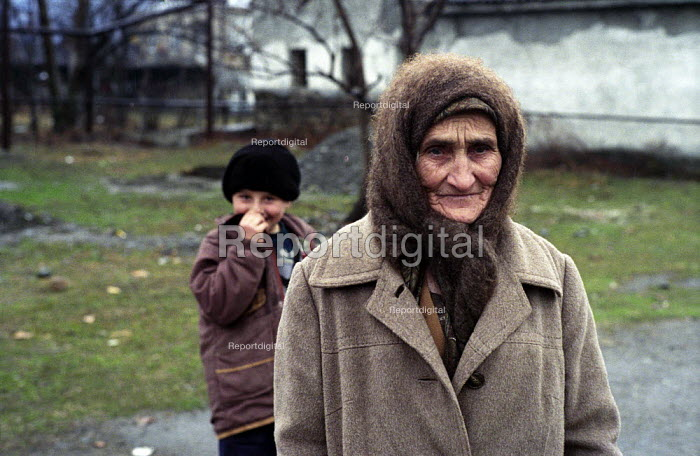 Elderly Chechen refugees living in a camp formerly a Soviet military camp in Georgia. The refugees from Grozny and nearby villages had walked to Georgia. Duisi, Pankisi Gorge, Georgia 2003 - Thomas Morley - 2003-02-05