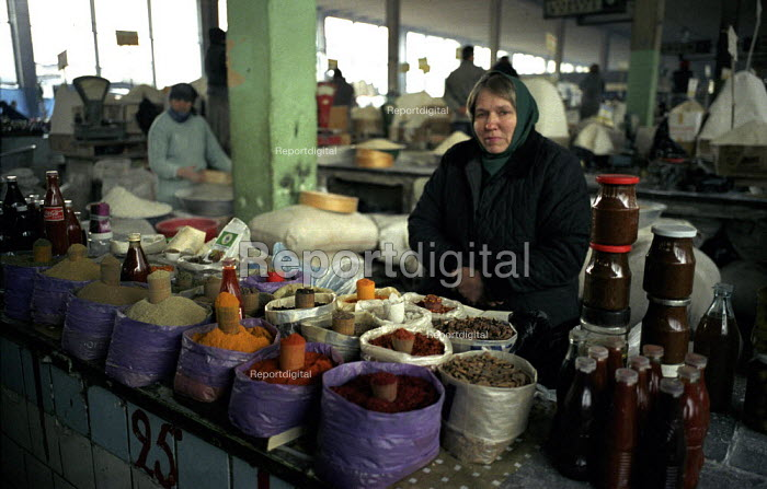 An Abkhazian woman sells herbs and spices in the Abkhaz market, Tbilisi Georgia. The market is run by the Abkhazian Georgian refugees and has at times been a place of tension between them and indigenous Georgians. More than 350,000 refugees were created as a result of the conflict when Abkhazia tried to gain independence from Georgia. Georgia 2003 - Thomas Morley - 2003-03-05