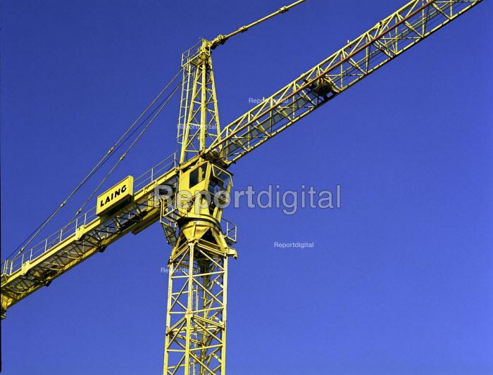 Yellow crane against blue sky on a construction site - Len Grant - 2001-09-03