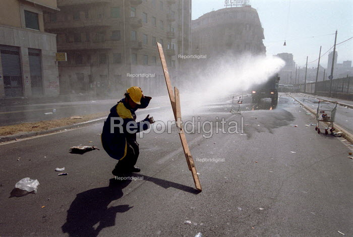Anti Capitalist being hit by water cannon from riot police , Genoa G8 summit. - Paul Mattsson - 2001-07-20