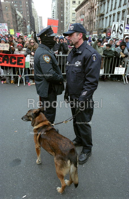 New York Police Department officers on duty at the stop the war on Iraq rally on First Avenue, New York City, USA. Up to one million people attended the demonstration. It was the largest protest that the city has seen for many years, it formed part of the world wide anti war day of protest. - Paul Mattsson - 2003-02-15