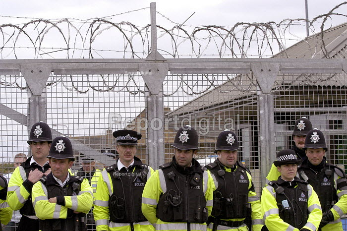 Police guarding the main gate of RAF Fairford during an anti war protest - Paul Mattsson - 2003-04-06