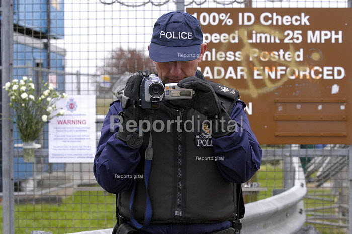 Police video camera operator filming anti war protest at the main gate of RAF Fairford - Paul Mattsson - 2003-04-06