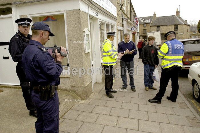 Anti war protesters gathering in Fairford village are questioned and filmed by Police Forward Intelligence Team using special powers under the Terrorism Act - Paul Mattsson - 2003-04-06