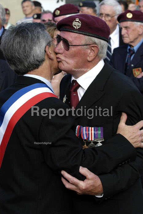 British airborne war veteran kisses and embraces a council official after receiving a commemorative medal from him at local small town D Day sixtieth anniversary commemoration ceremony, Trouarn, Normandy, France - Paul Mattsson - 2004-06-06