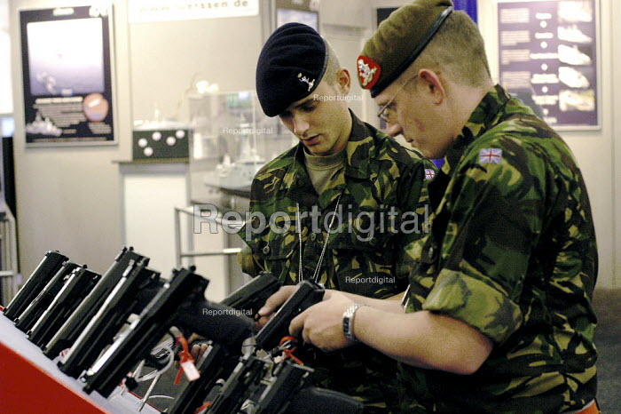 British soldiers trying Heckler and Koch semi automatic pistols. Defence Systems and Equipment International Exhibition, Excel, Docklands - Paul Mattsson - 2003-09-09