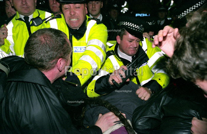 Stop the War Coalition Day of Action, police grapple with protesters in Whitehall trying to break through police lines in order to get to Downing Street - Paul Mattsson - 2002-10-31