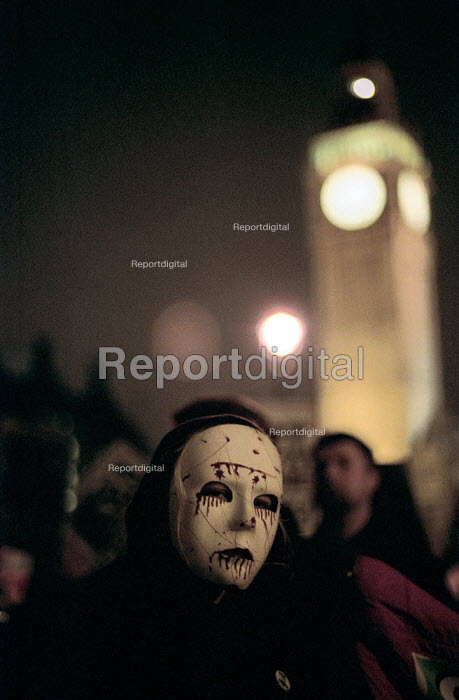Stop the War Coalition Day of Action, protester in Halloween mask outside the Houses of Parliament - Paul Mattsson - 2002-10-31