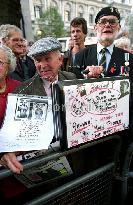 Demonstration outside the Department of Work and Pensions,Whitehall calling for an increase in the State Pension. Organised by the National Pensioners Convention, Armistcee Day - Paul Mattsson - 2002-11-11