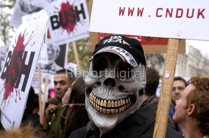Stop The War Coalition demonstration against the visit of US President George W Bush to the UK.Protester wearing a death mask on the march through London - Paul Mattsson - 2003-11-20