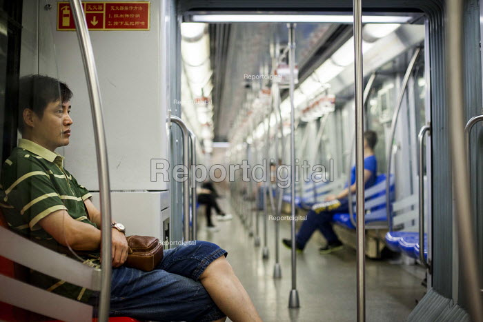A near empty train carrige on Shanghai subway system is seen towards the end of the day. Shanghai, China. - Connor Matheson - 2015-09-02
